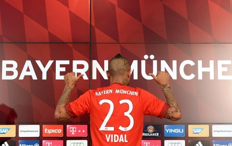 German first division Bundesliga football club Bayern Munich's new recruit Chilean midfielder Arturo Vidal shows his jersey during a press conference on July 28, 2015, in Munich, southern Germany. Vidal is set for his second stint in the Bundesliga having spent four seasons at Bayer Leverkusen from 2007-2011.  AFP PHOTO / CHRISTOF STACHE        (Photo credit should read CHRISTOF STACHE/AFP/Getty Images)